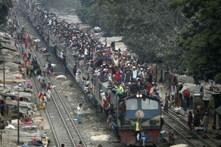 """OverLoaded Train"" in India, more and more people are crammed into the same space, trying to live, breathe, grow food, find jobs and enjoy 'quality of life'.  In a country of 1.26 billion people (and still growing rapidly!) is there any room for tigers or elephants or other creatures?  Photo from churchandstate.org.uk"