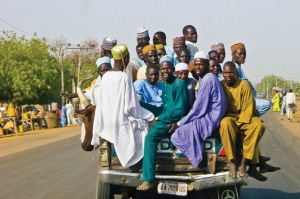23 men and 1 bovine in the back of a mini-truck in Northern Nigeria.