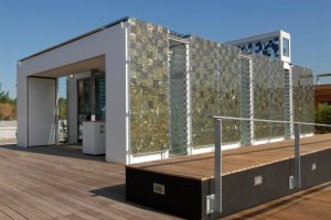 This glass house eco home was designed at Stuttgart University so that it produces more energy than it uses, thus feeding into the national grid.